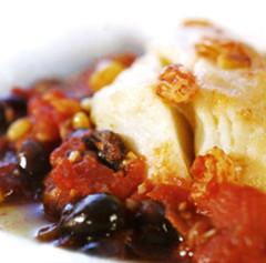 Baccalà con pomodori e olive nere